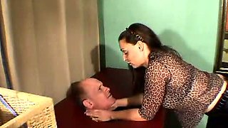 Dominatrix in leather pants abuses him