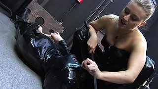 Serf in latex gets it hard from his dominatrix