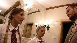Schoolgirls share a teacher