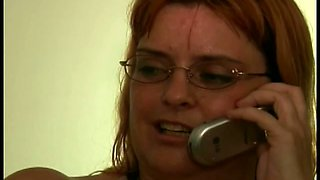 Perverted amateur redhead housewife in glasses sucks two dicks at once