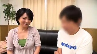 Lustful Japanese lady has a young man fingering her snatch