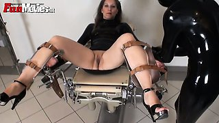 Milf slave loves to get locked in a gyno chair