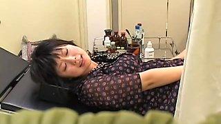 Naughty nurse fucks a Jap babe with her strapon pecker