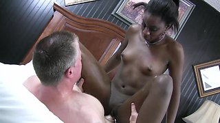 Black chick that loves to ride cock is pulling a white one with her hands