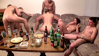Hot ladies are with some guys and a lot of booze at a group sex party