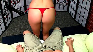 Slender blonde drops her red bikini and delivers a footjob
