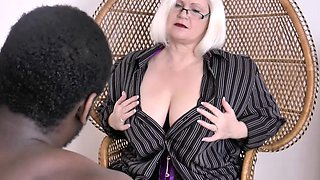 Grandma Lacey poses and sucks large black younger cock