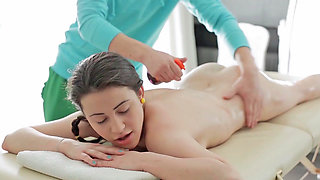 Petite lady is on her stomach and she is being massaged