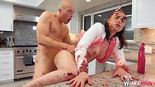 Hot brunette is getting nailed in the kitchen, after eagerly sucking dick as deep as she could