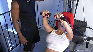 Seductive cougar with big tits being smashed doggy style in an interracial sex