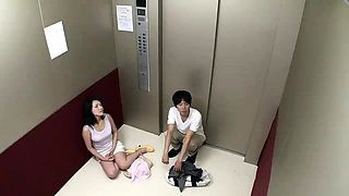 Japanese couple stuck in broken elevator spend time fucking