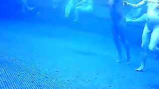 Voyeur cam vid of a bunch of naked people in pool