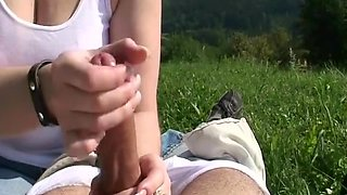 Wanking his hard strapon outdoors