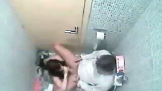 Couple fucking on the toilet bowl