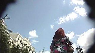 Redhead woman upskirted