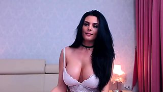 Ravishing camgirl flaunts her big hooters and rubs her pussy